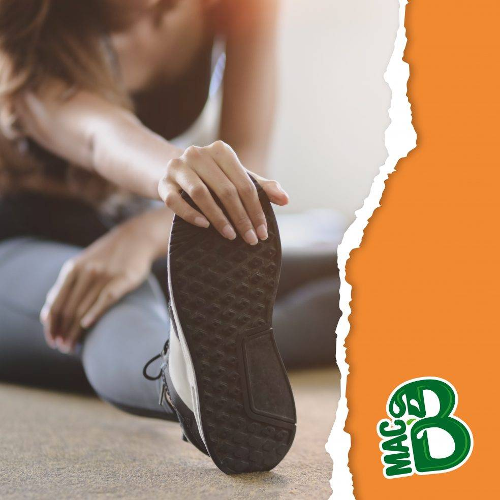 Woman stretching leg with Macb logo